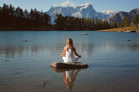 Woman finds peace in mountain lake
