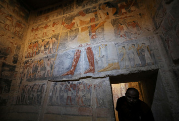 A tourist passes through the entrance of a chamber of the tomb of Mehu after it was opened for the public at Saqqara area near Egypt's Saqqara necropolis, in Giza