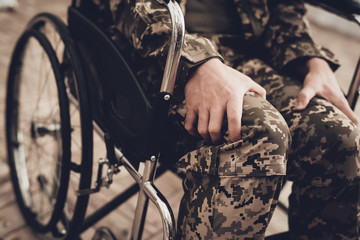 Disabled Soldier In A Wheelchair. Paralyzed Man.