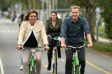 Isabella Lovin and Gustav Fridolin, Spokespersons for the Green Party, ride bikes to join the Peoples Climate March in Stockholm