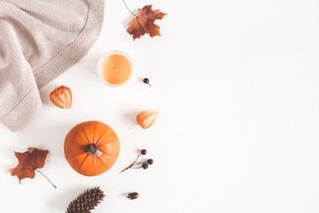 Autumn composition. Pumpkins, plaid, candles, dried leaves on white background. Autumn, fall, halloween concept. Flat lay, top view, copy space