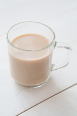 Spoed Foto op Canvas Milkshake Glass mug of hot cocoa coffee drink