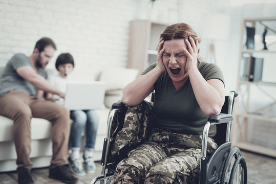 Disabled Soldier In Wheelchair. Suffer From Pain.