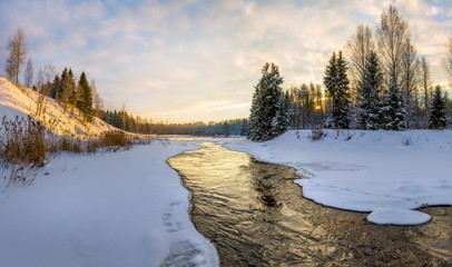 Winter river. Good New Year spirit. Pine and spruce in the snow. Magic clouds. Panoramas.
