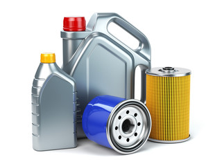 Car oil filter and motor oil canisters isolated on white background. Auto service and car maintenance concept.