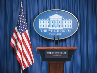 Politics of White House and President of USA United states concept.  Podium speaker tribune with USA flags and sign of White House Fotomurales