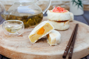 Vietnamese durian cake on wooden board. Traditional asian pastry.