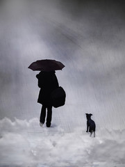 Silhouette of a woman and a dog in the rain