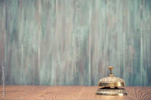 Vintage Bronze Hotel Reception Service Desk Bell Front Grunge Wooden Wall Background Old Retro Style
