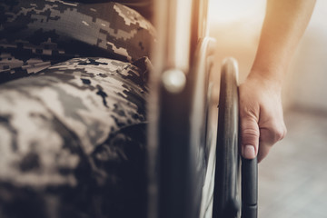 Disabled Soldier In A Wheelchair. Paralyzed Woman.