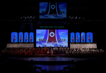 Singers and soldiers perform during a concert on the eve of 70th anniversary of North Korea's foundation in Pyongyang