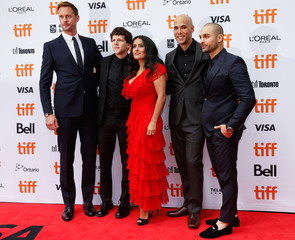 Actors Alexander Skarsgård, Jesse Eisenberg, Salma Hayek  and Michael Mando pose with director Kim Nguyen (2nd R) at the world premiere of The Hummingbird Project at the Toronto International Film Festival (TIFF) in Toronto