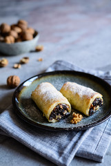 Mini strudels stuffed with dried plums, cranberries and walnuts