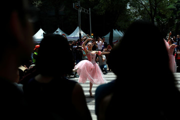"""The classical ballet company """"Ardentia"""" performs in the streets of Mexico City on traffic lights, in an effort to highlight the city's fine arts in public spaces in Mexico"""