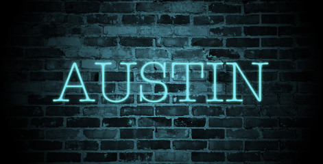 first name Austin in blue neon on brick wall