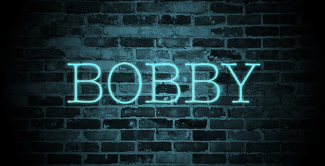 first name bobby in blue neon on brick wall