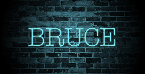 first name bruce in blue neon on brick wall