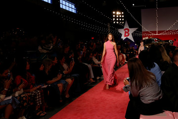 Gigi Hadid presents a creation from Brandon Maxwell Spring/Summer 2019 collection during New York Fashion Week