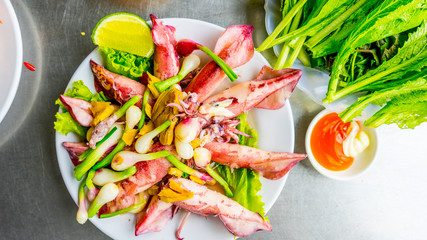 Vietnamese sea food, plate of steamed ginger sea squid, popular sea food of coastal people in Vietnam