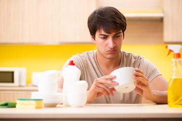 Man washing dishes at home