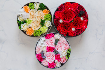3 round boxes of flower