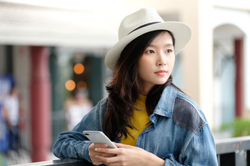Young asian woman using smart phone in city outdoors background, people outdoor with technology, people on phone, lifestyle