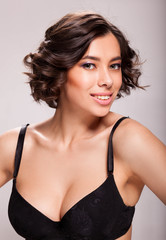Photo of beautiful sensual woman in black bra, showing face expression