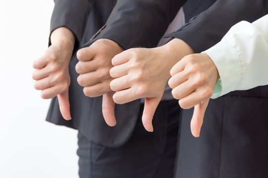 Group of Business show dislike or unlike thumbs down hand