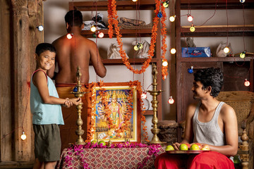A group of young men prepare to worship at a Hindu Altar (Staged)