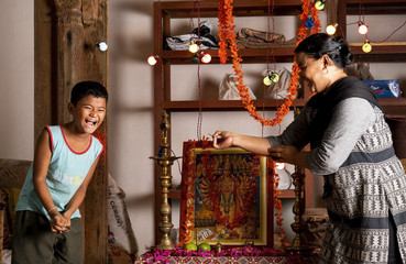 A mother and son laugh on a light moment (Staged)