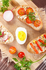 Baguette or sandwiches with mackerel or tuna fish paste on jute burlap