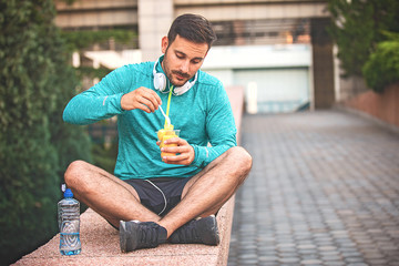 Man is eating fruit after morning workout