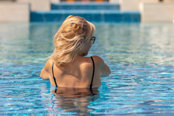 Blonde woman in the swimming pool