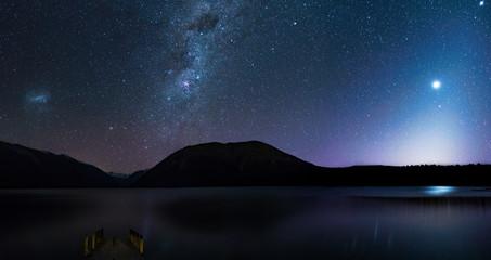 Panorama, Amanzing Starry night at Lake Rotoiti. Reflection of the Milky way and galaxy on the lake. Nelson Lake National Park, New Zealand.
