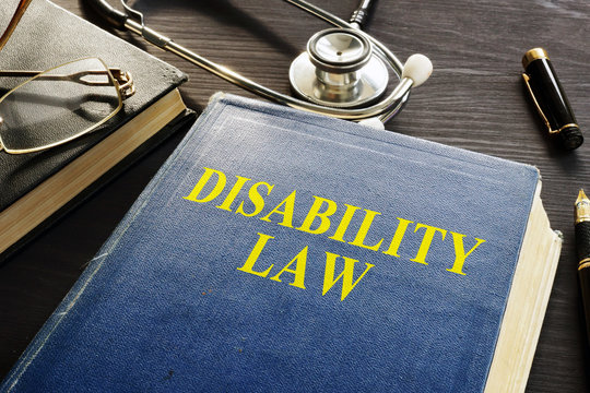 Disability Law book and stethoscope on a desk.