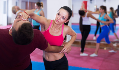 Woman training self-defence moves