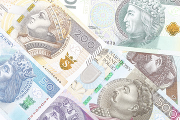 Polish Zloty, a business background with banknotes