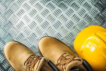 Waterproof boots building helmet on channeled metal sheet