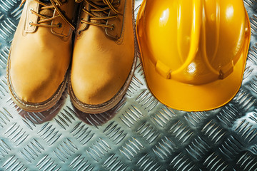 Protective boots hard hat on fluted metal sheet