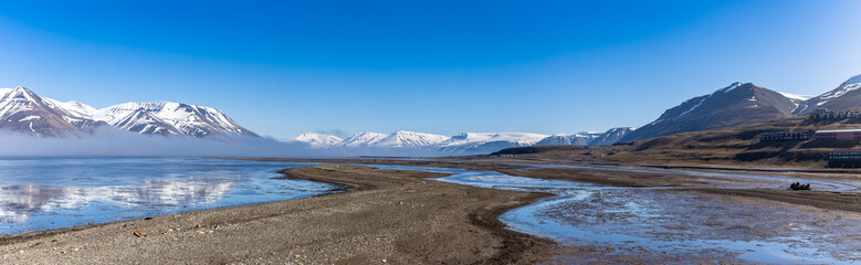 Panorama of Adventdalen surrounded by snowy mountains