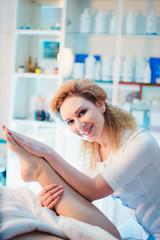 Woman having spa body massage treatment in the spa salon.