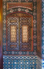 Embedded vintage cupboard painted with colorful floral patterns at Syrian hall of historic Manial palace of Prince Mohammed Ali, Cairo, Egypt