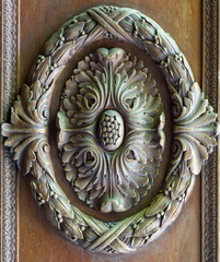 Floral engraved decorations of a royal era wooden ornate door leaf, Manial Palace of Prince Mohammed Ali, Cairo, Egypt