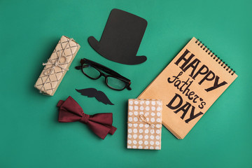 Flat lay composition with bow tie, gift boxes and paper decor on color background. Happy Father's Day