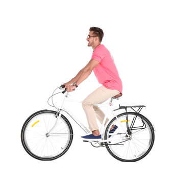Handsome young hipster man riding bicycle on white background