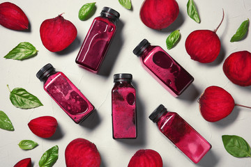 Flat lay composition with beet smoothies on light background