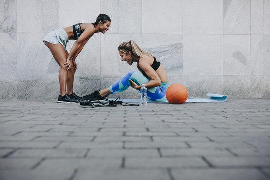 Happy fitness women training outdoors
