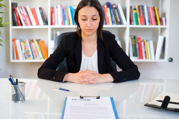 Young woman portrait with cv in office