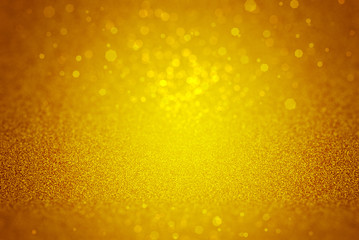 Gold sparkle rays lights with bokeh elegant show on stage abstract background. Dust sparks background.