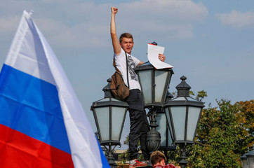 A protester shouts during a rally against planned increases to the nationwide pension age in Moscow